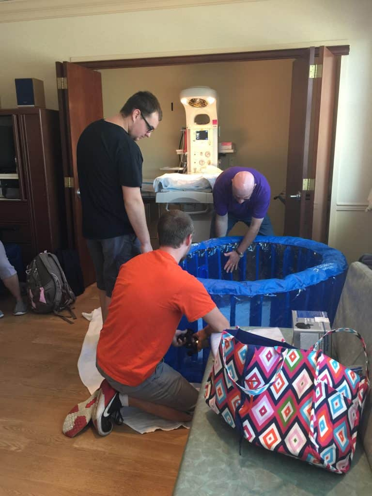 Birth Story: Men setting up birthing pool