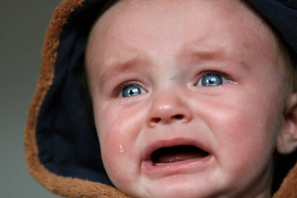 crying baby in hood- 6 Things you shouldn't say to a new mom- Growing The Tuckers