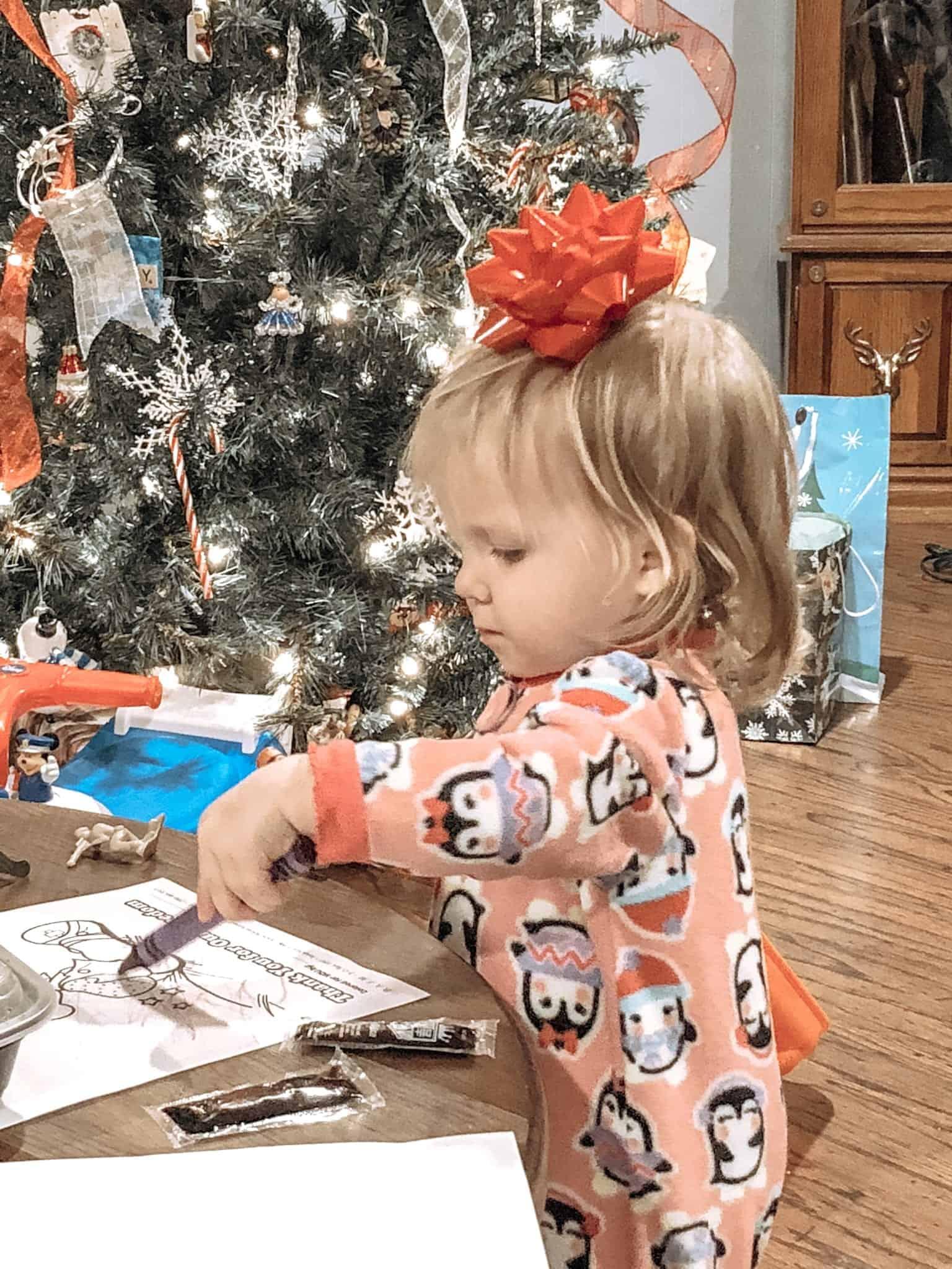 toddler at Christmas coloring