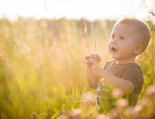 Baby in the grass and sunshine