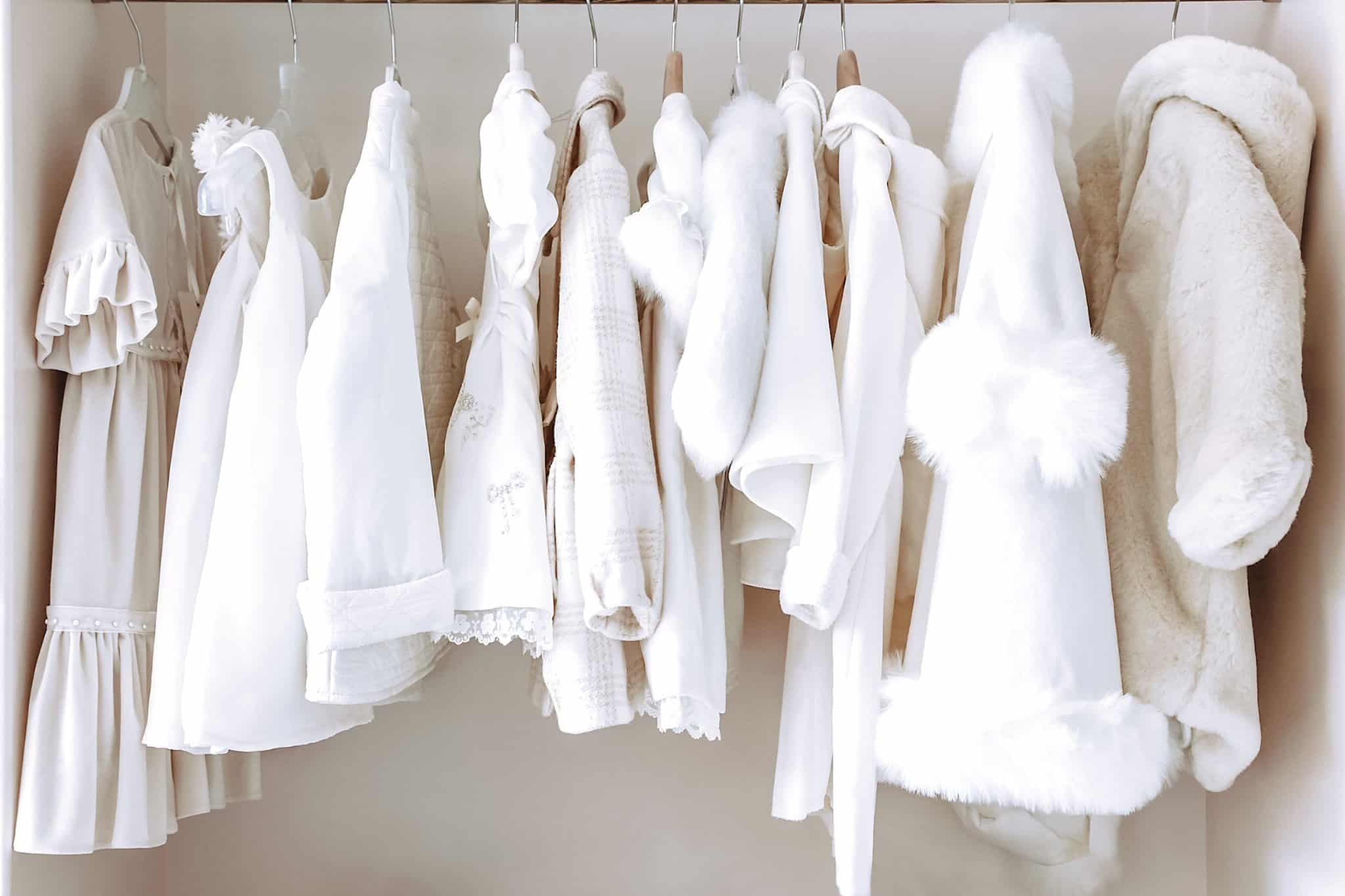 baby clothing hanging in closet